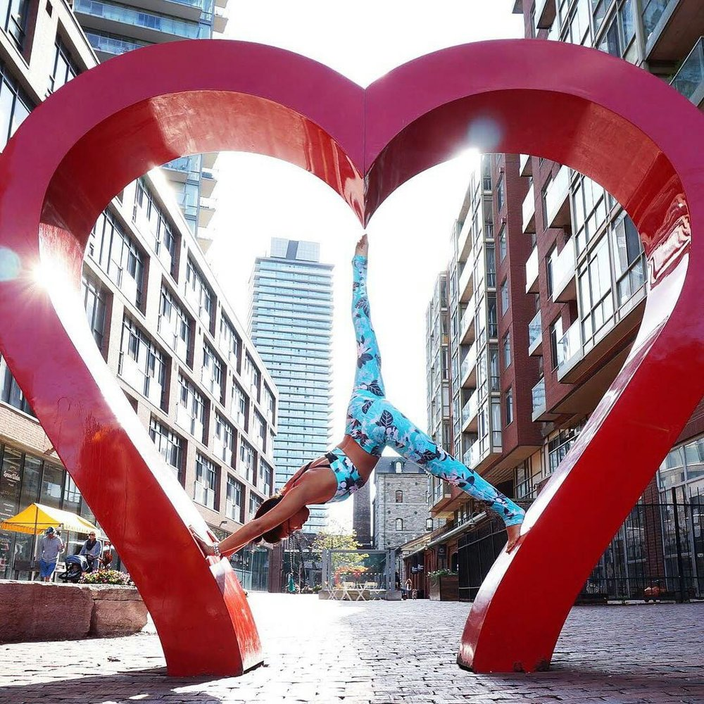 All you need is love and yoga. Amazing yoga pose and lines by Su from Toronto in the Distillery district.