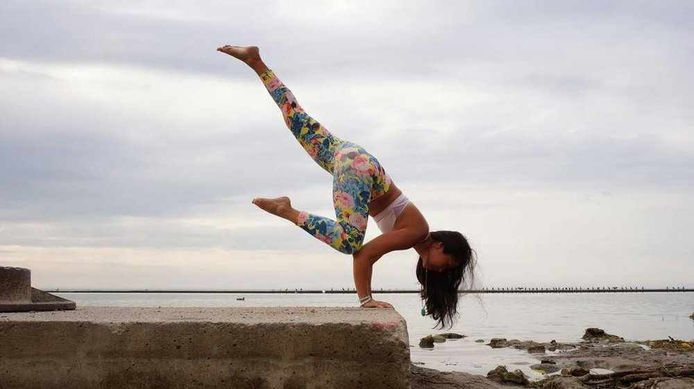 Yogi pose at the waterside. Su from Toronto doing yoga in Aura bracelets.