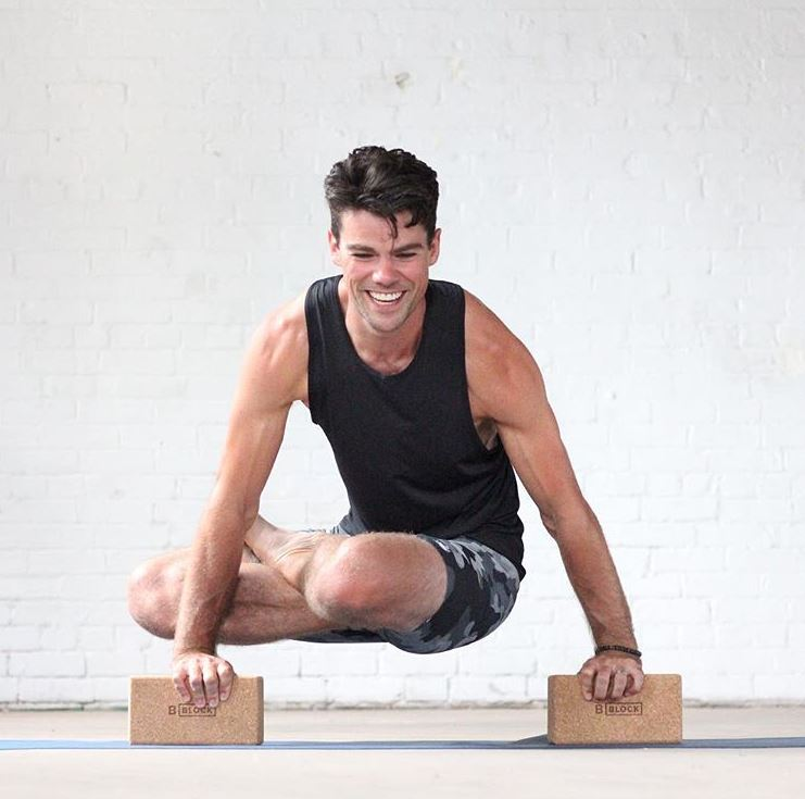 Toronto yoga teacher, Jonathan, wearing an Aura bracelet in Picasso Jasper