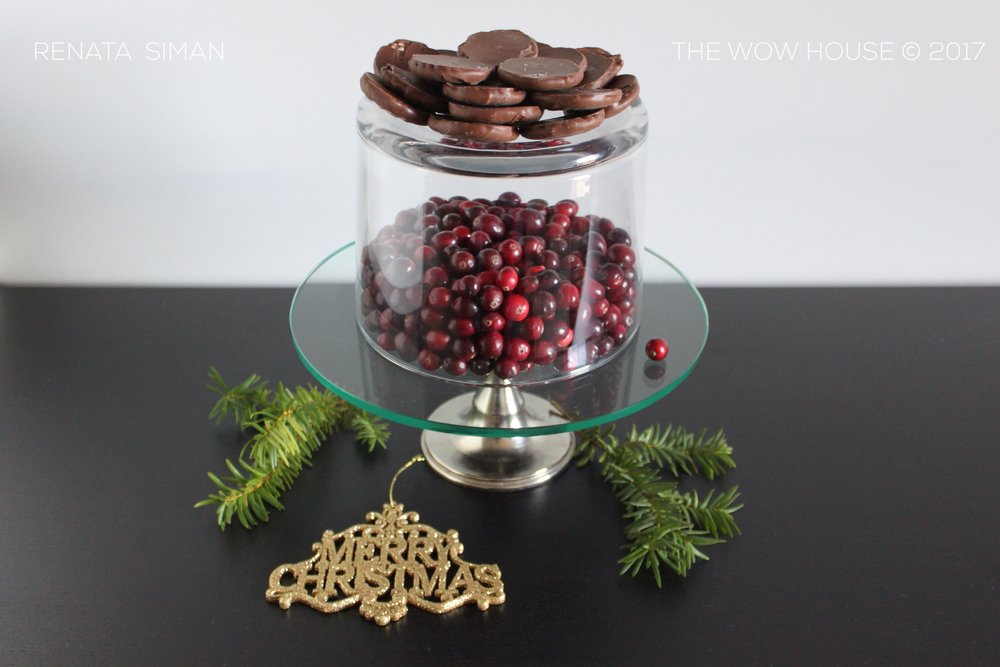 Cake stand + Bowl upside down. Cranberries inside, chocolates on top.