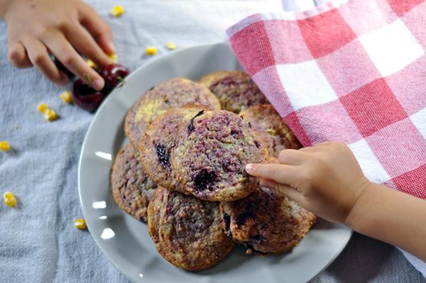 Cherry Swirled Corn Cookies_ plated 2 hands.jpg