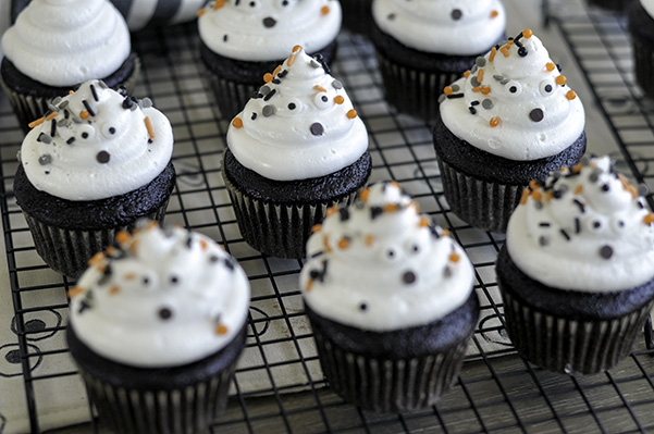 Chocolate Ghost Cupcakes_decorated on wire rack.jpg