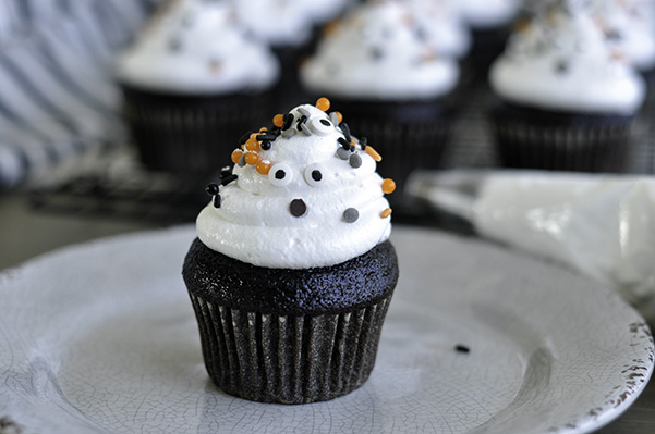 Chocolate Ghost Cupcakes_single decorated face.jpg