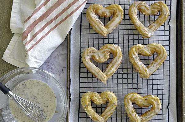 Honey Lavender French Crullers_Donut overhead cooling rack straight.jpg