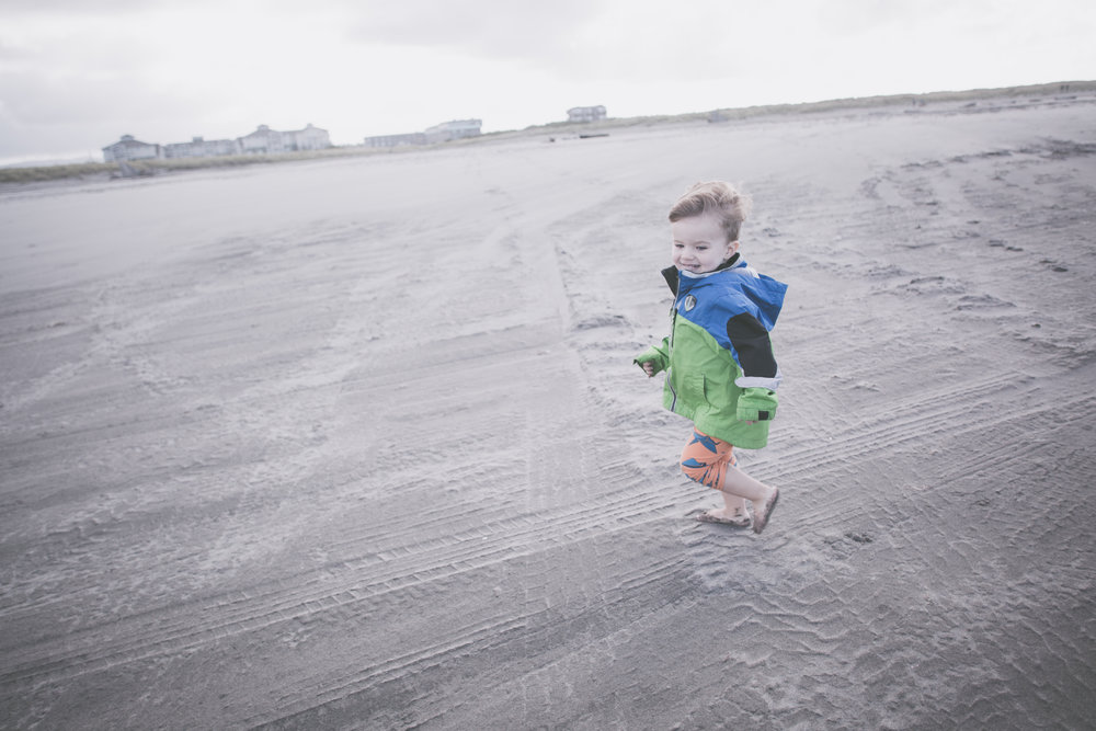 Even on this cloudy day there was enough light outside for me to use the high shutter speed that captured my little guy tearing across the sand!