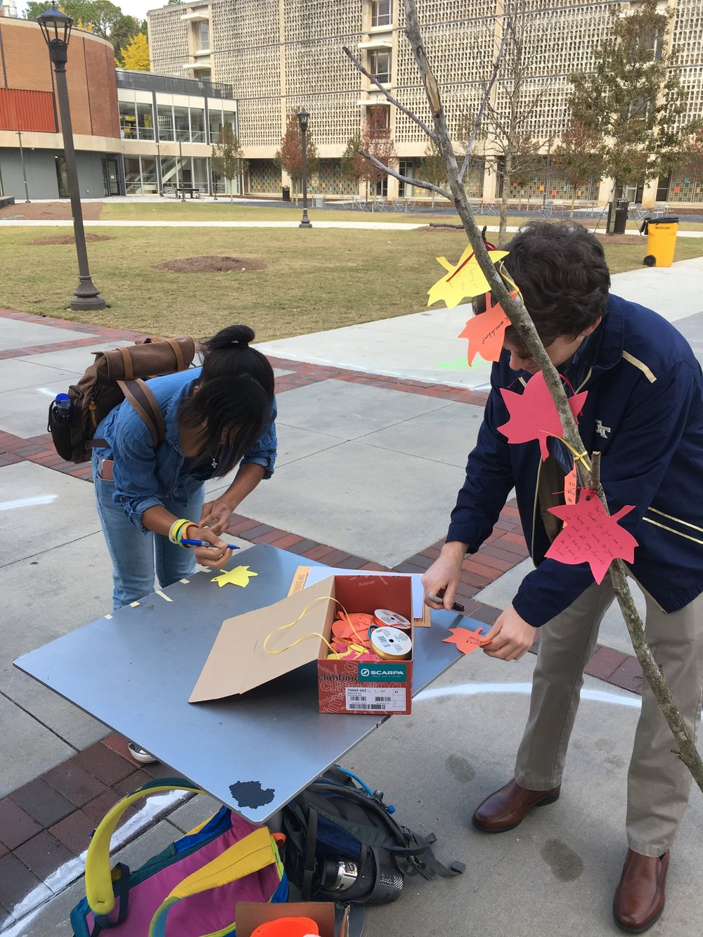 Student pedestrians writing what they're thankful for