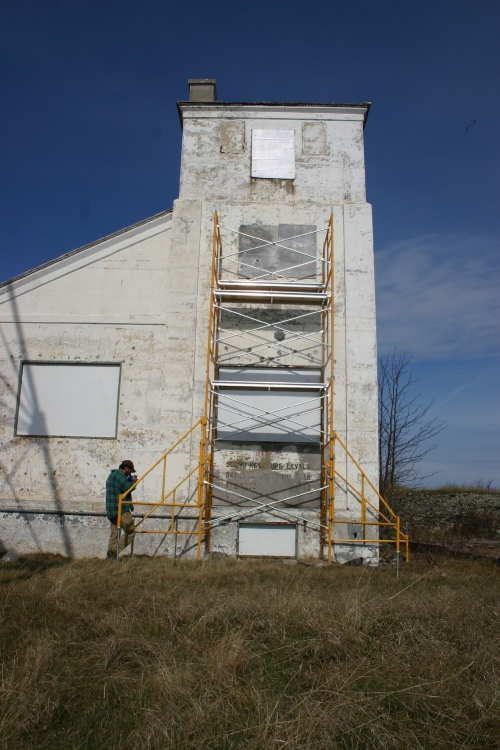 Replacing security panels on the Manitou Island Fog Signal building.