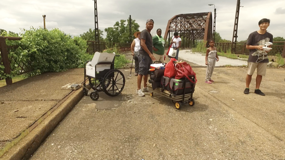 Jun Bea testing the drone footage on closed-down Black Bridge with Charmain Savage, her granddaughter, Janiene and DWB.