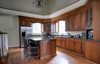The kitchen is open and functional but the wood cabinets with the wood floors was just dating the overall look
