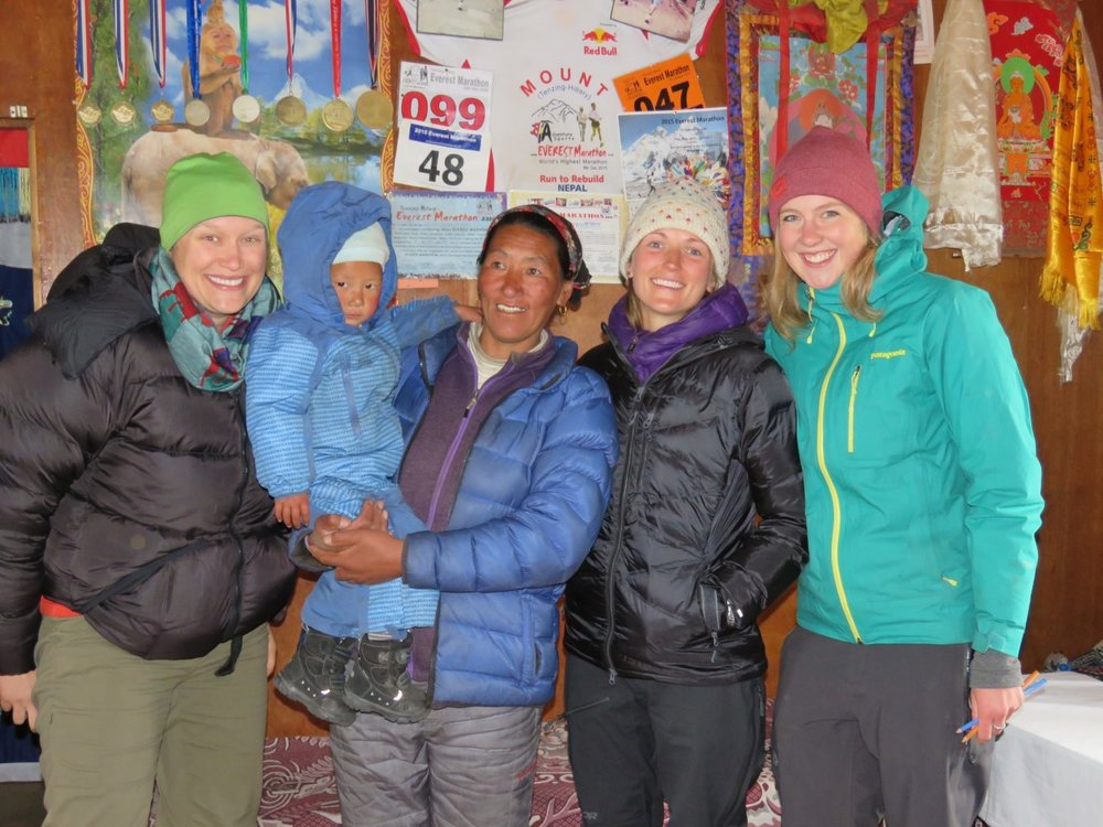 Ang Dami Sherpa with her son and marathon medals in the background