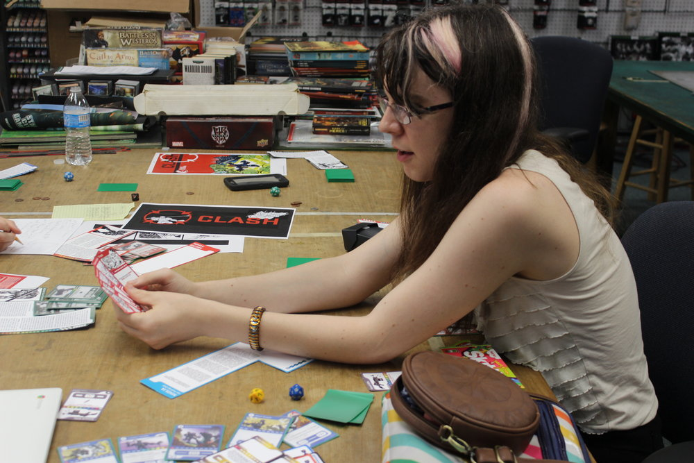 Developer Freya Crowe playtesting CLASH at Little Wars game store in Baton Rouge Louisiana. Photograph: Cathy Carnes/Duzax Studios