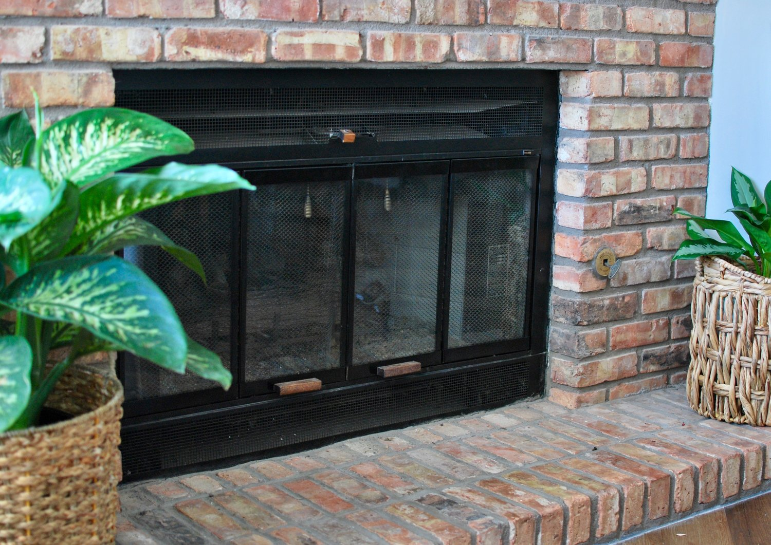 Paint Your Fireplace Brass Trim For An Instant Updated Look