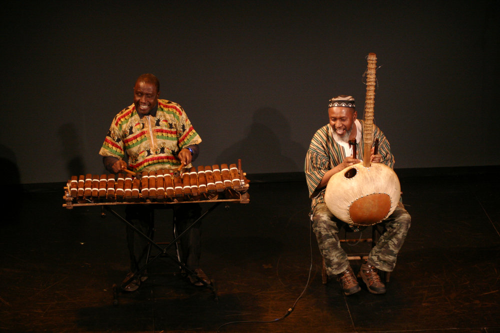 West African musicians Ebrima Jassey (Balafon) and Salieu Suso (Kora). Photo by Elisa Gutierrez