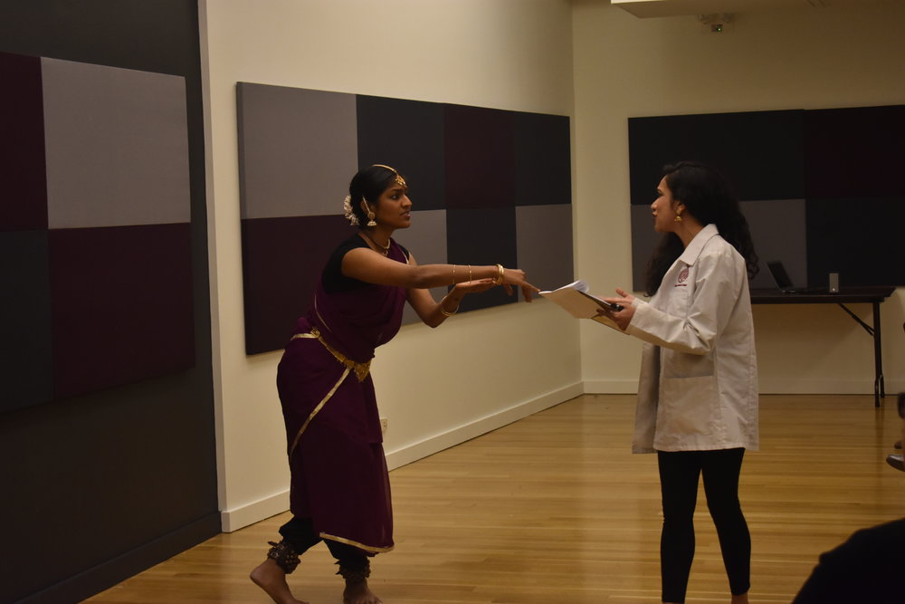 Dancer Shilpa Darivumela and spoken word artist Jennifer Chowdhury perform Bagalamukhi's Words, in which they explore how medical jargon disempowers the physician-patient relationship. Photo by Mollie Block