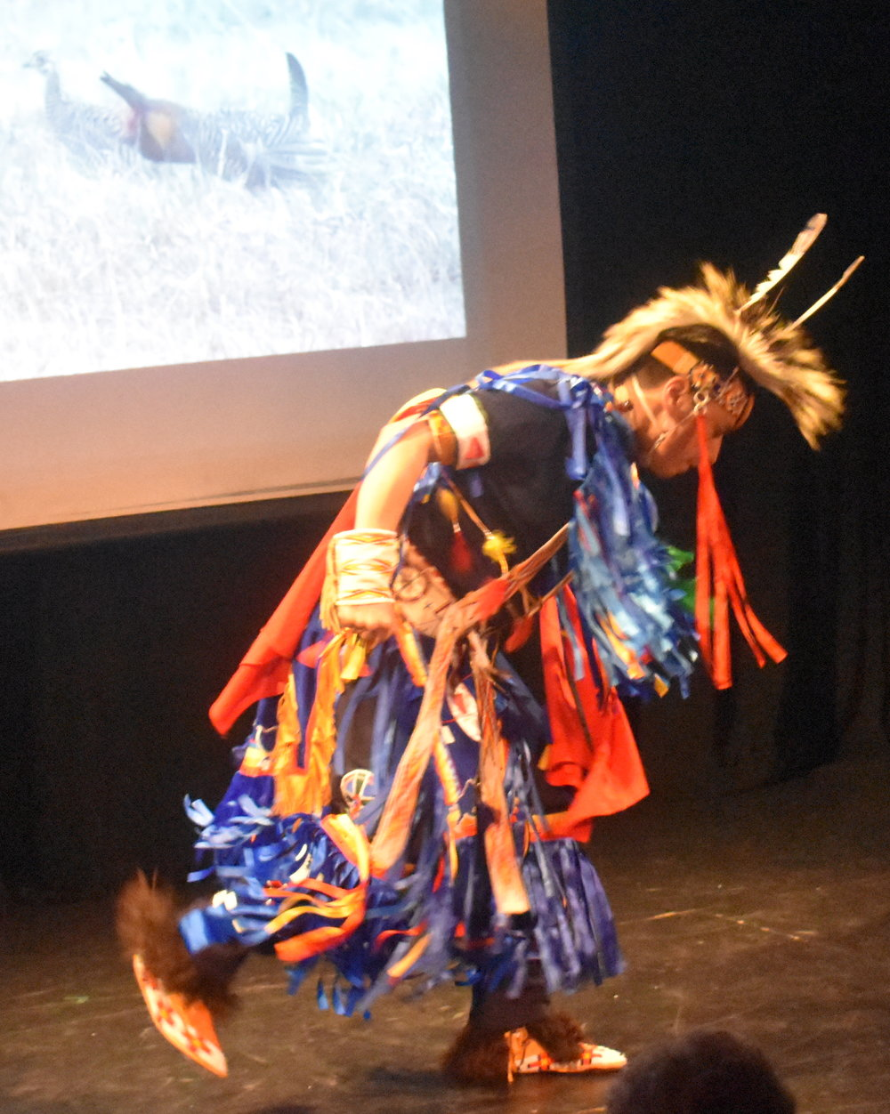 "Sheldon Raymore interpreting ""Earth"", with a Native American Grass Dance. Photo by Mollie Block"