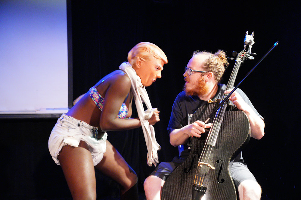 Cellist Jacob Cohen and performance artist Uniska Wahala Kano. Photo by Steven Pisano