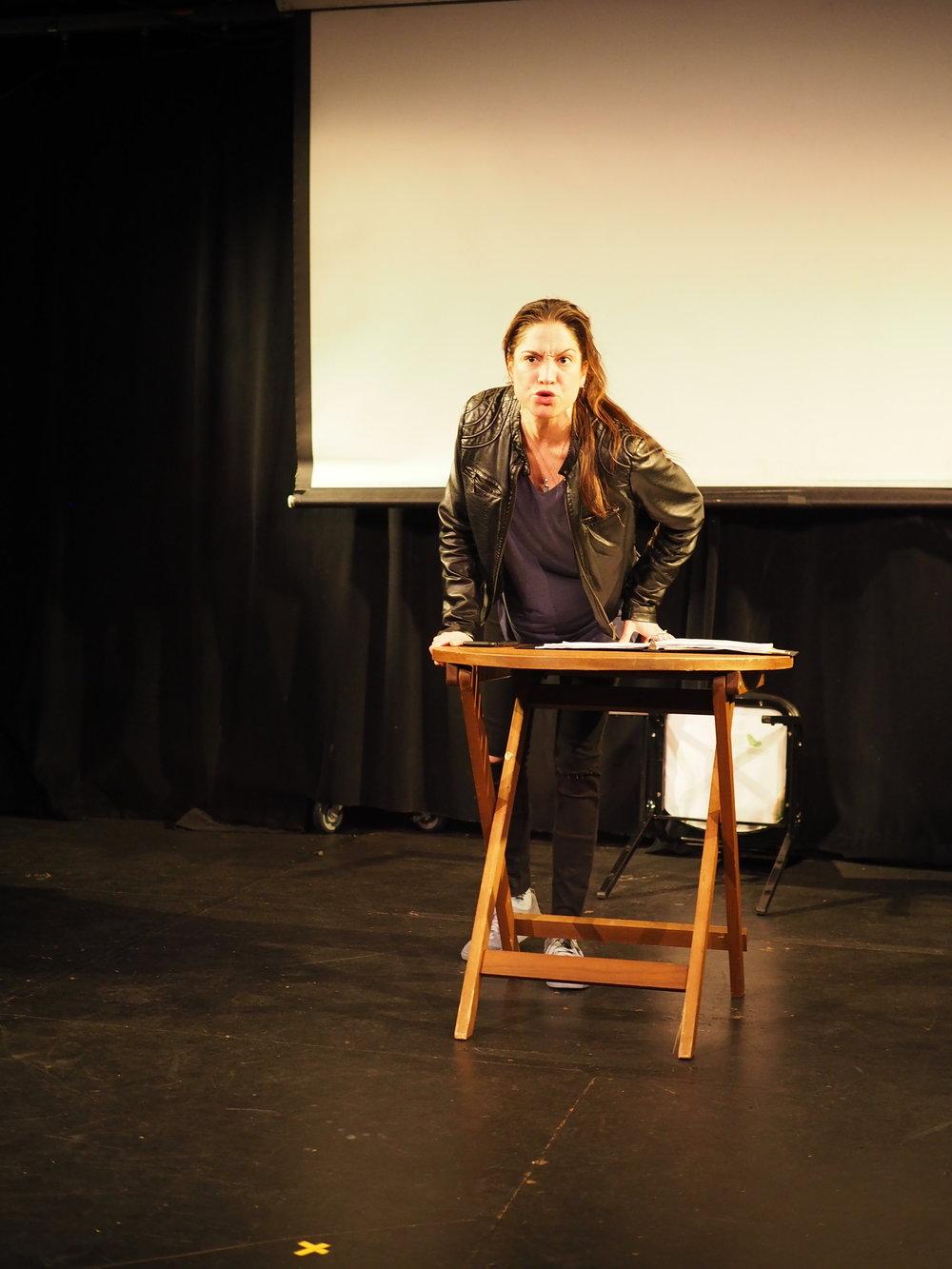 """Valeria Avina performing in Sara Farrington's one-woman play """"Honduras."""" Photo by Oxana Chi"""