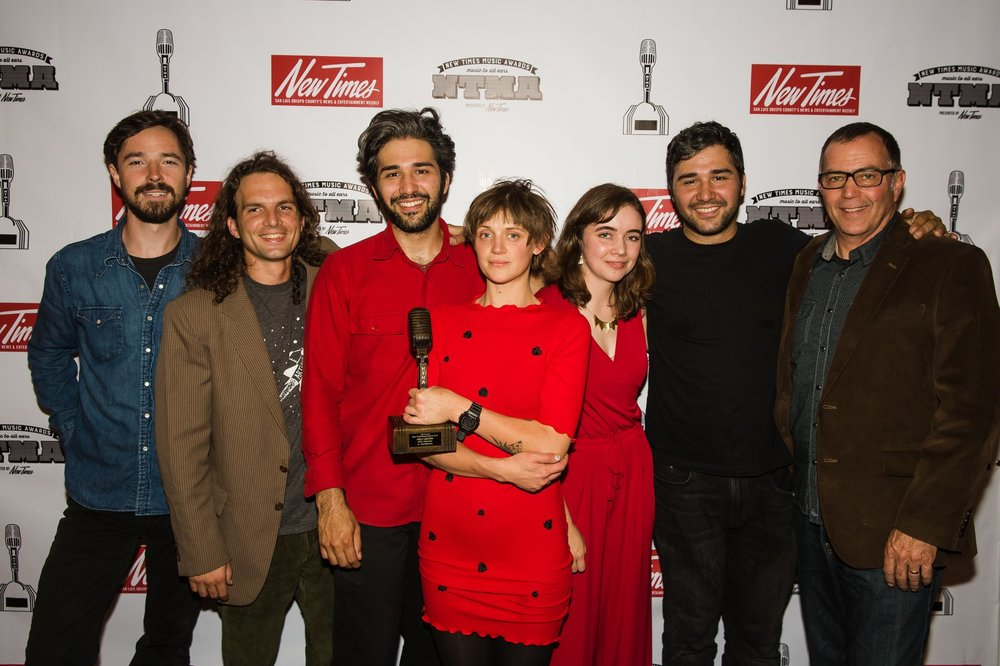"After being presented with our award for ""Best Rock Song"" (for  Holy Lighter ) at the 10th Annual New Times Music Awards."