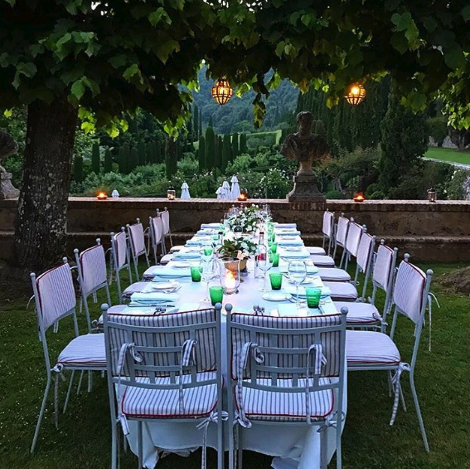 "A magical dinner scene at  Villa Cetinale , ( @cetinale ) in Tuscany. I adore the green glasses. Get the look ""for less""  HERE."