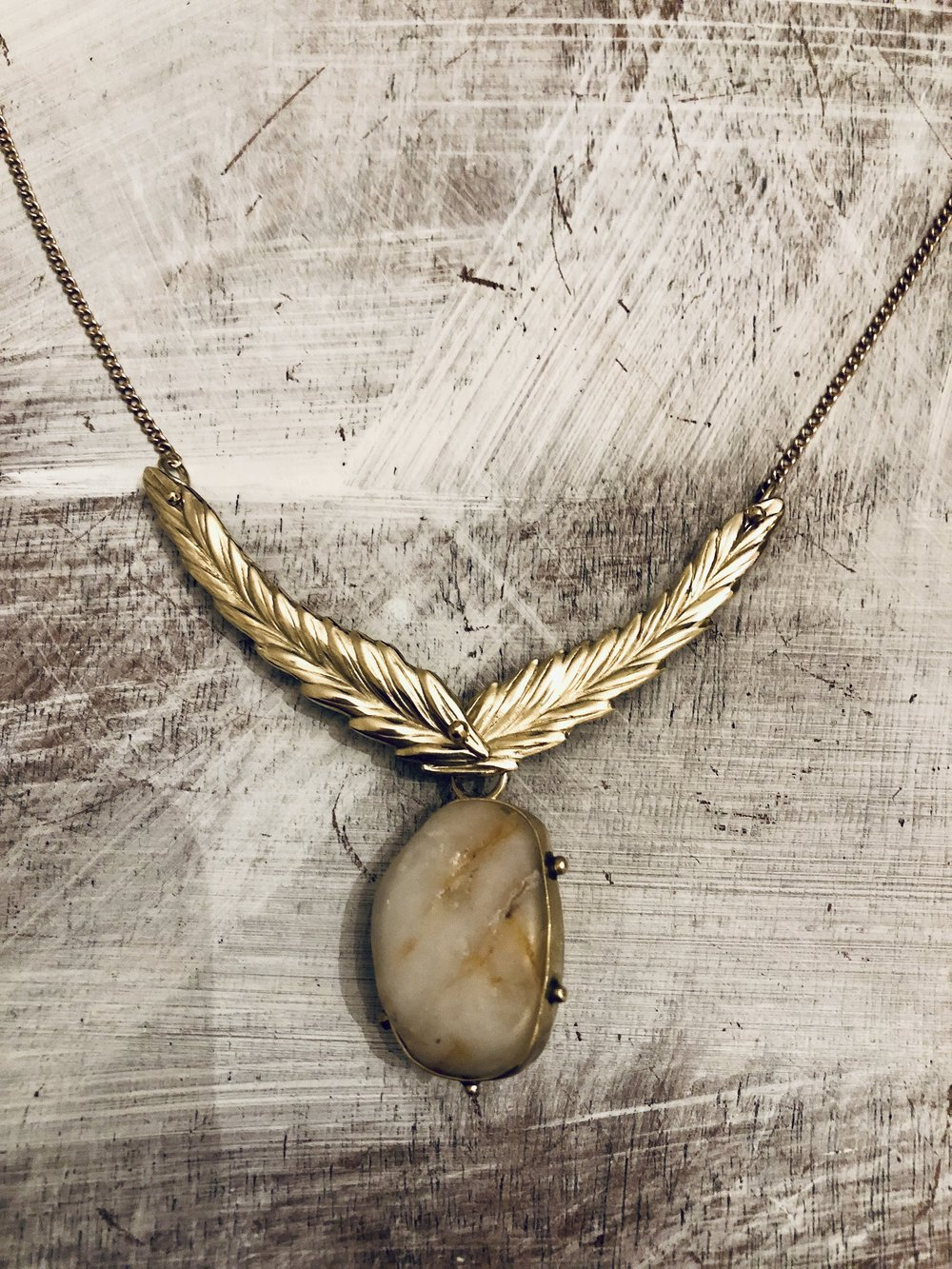 4.  AFTER : found rock necklace, 18k yellow gold leaves