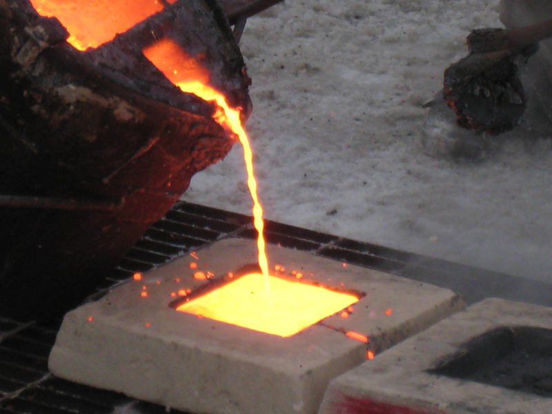 Red-hot liquid iron is poured into the sand molds.