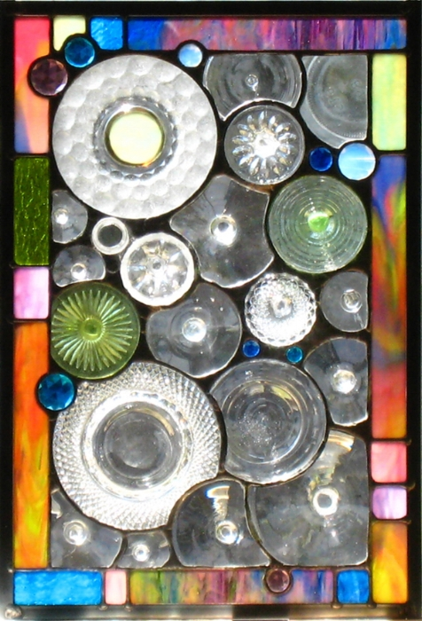 Brian and Jan Loeffel Collection: Bases cut off of wine glasses and old water goblets were mixed in with an old textured plate and an ashtray to create this panel.