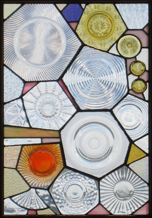 Polygonal Plates: Old glass plates of different sizes and textures were cut into various shapes and then organized next to one another to create this brightly glowing panel.