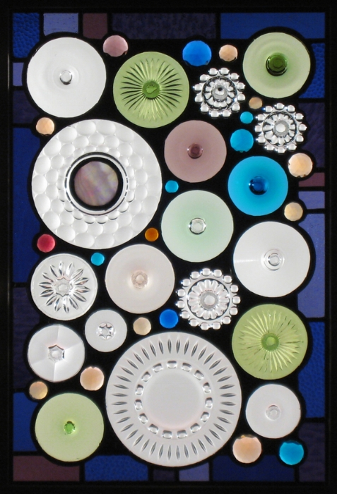 Dave and Jane Hebert Collection: Bases cut off of wine glasses and old water goblets were mixed in with an old textured plate and an ashtray to create this panel.