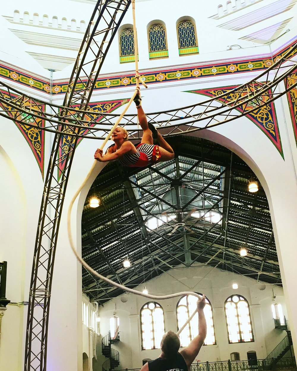 An aerial artist delicately balances above the crowd at the Circus Arts Smithsonian Folklife Festival.