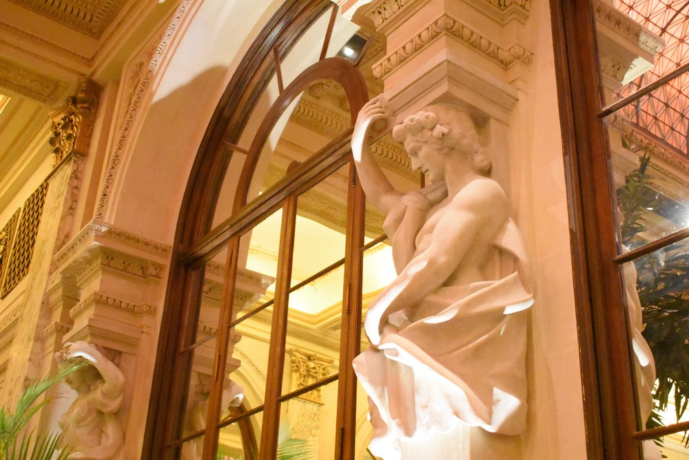 Detail of one of the allegorical statues on the walls of the Palm Court.