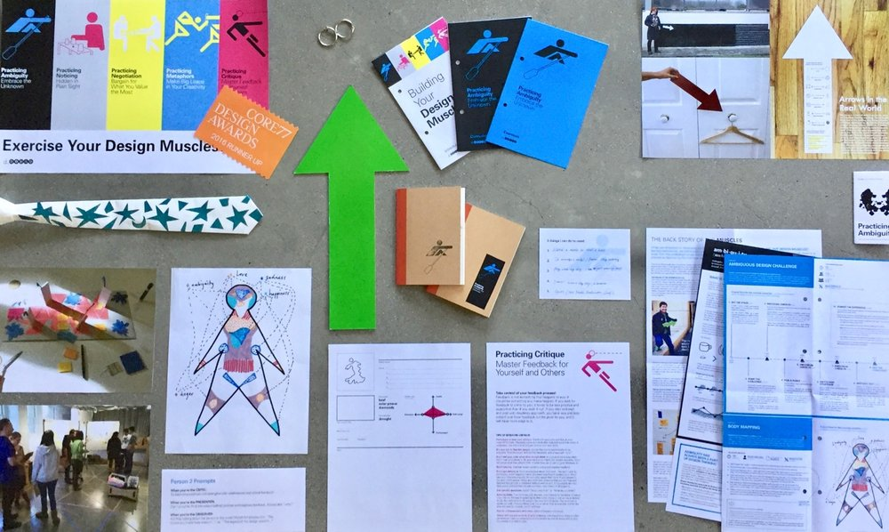 A knolling of artifacts from The Design Muscles, including posters, logbooks, zines, tools, booklets, prompt cards, and facilitator guides.