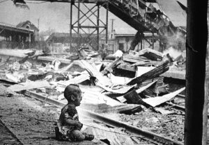 This terrified baby was almost the only human being left alive in Shanghai's South Station after brutal Japanese bombing. China, August 28, 1937. H.S. Wong. (OWI)NARA FILE #: 208-AA-132N-2WAR & CONFLICT BOOK #: 1131