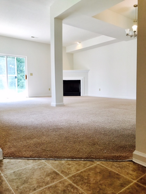 Adjoining Dining & Family Room with Gas Fireplace