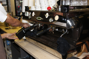 The portafilter is then attached to the Espresso Machine, which pumps water through the portafilter.