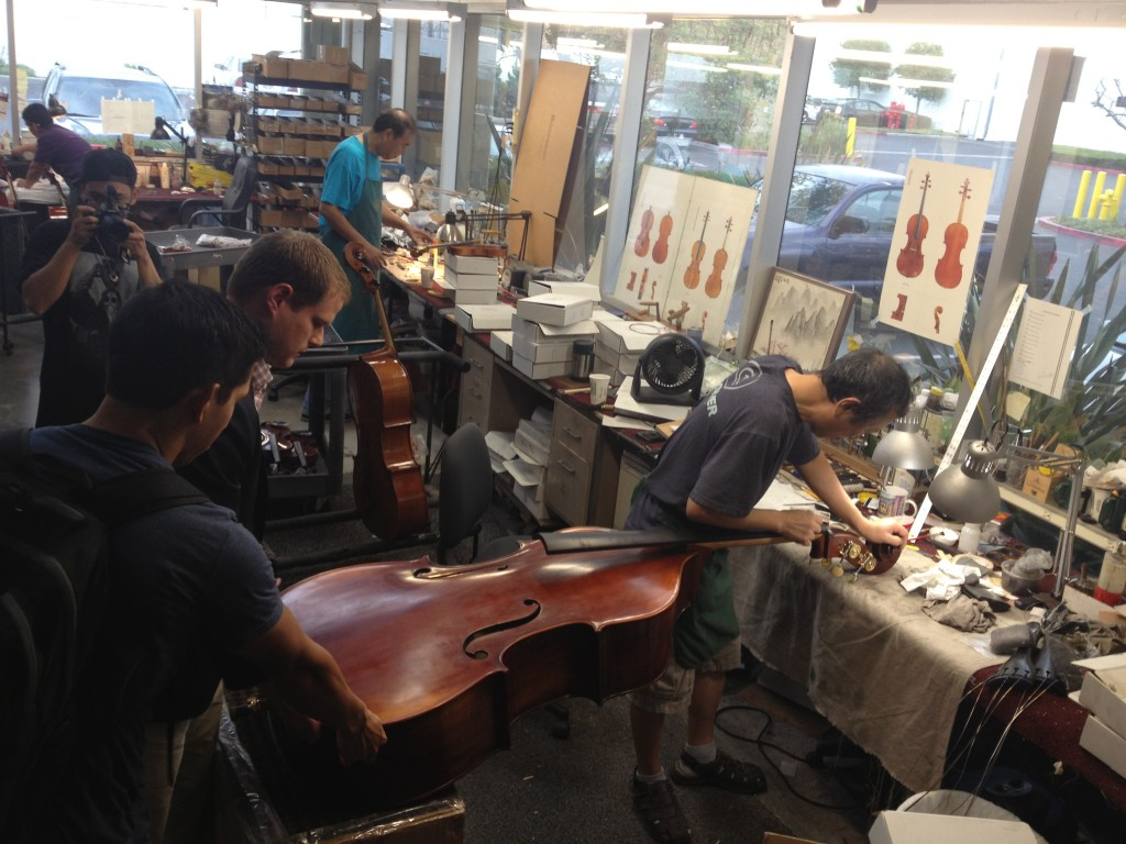 Working on a new bass in the Eastman factory.