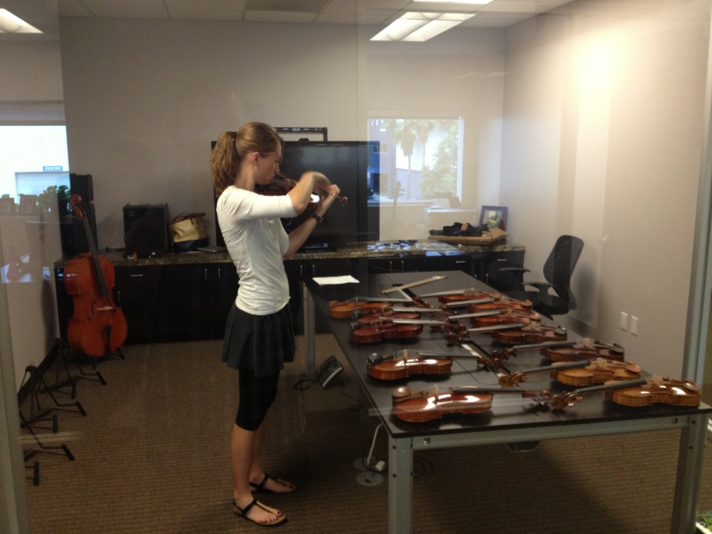 Olivia picking out her violin