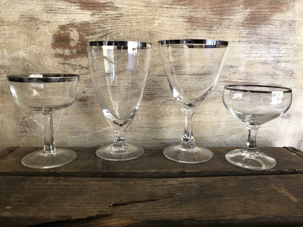 Mismatched vintage silver rimmed goblets. Water goblet, coupe, wine goblets Wedding rentals in Murrieta.