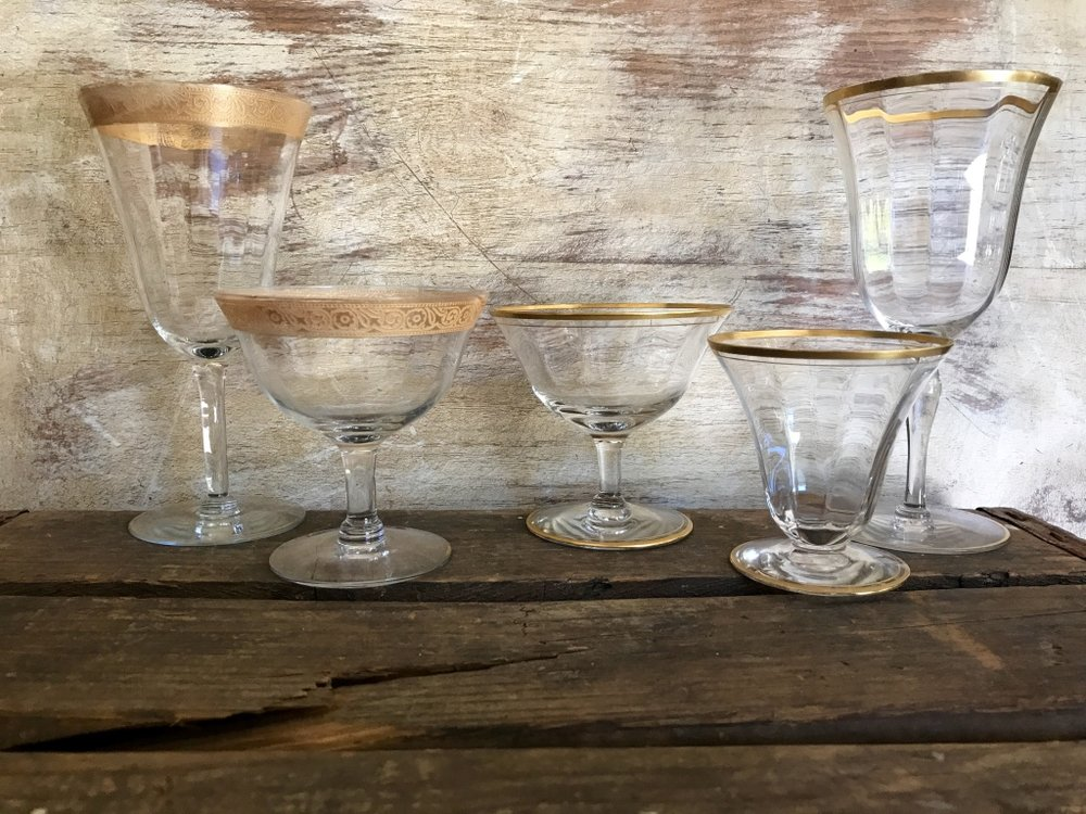 Vintage mismatched gold rimmed goblets. Water goblets, coupes, wine goblets, drinking glasses. Wedding rentals in the Temecula Valley.