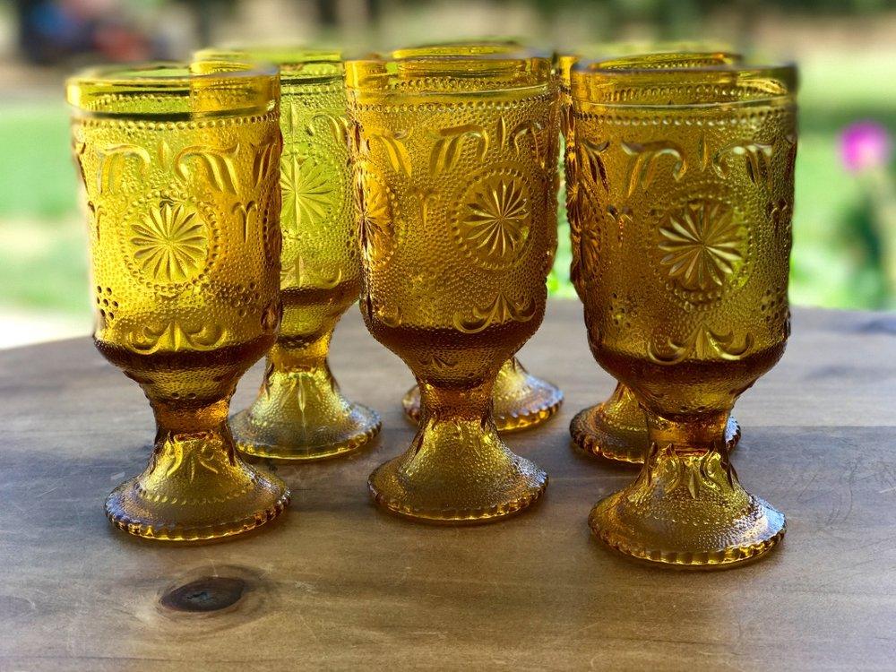 mismatched vintage mid century modern amber goblets and glasses.