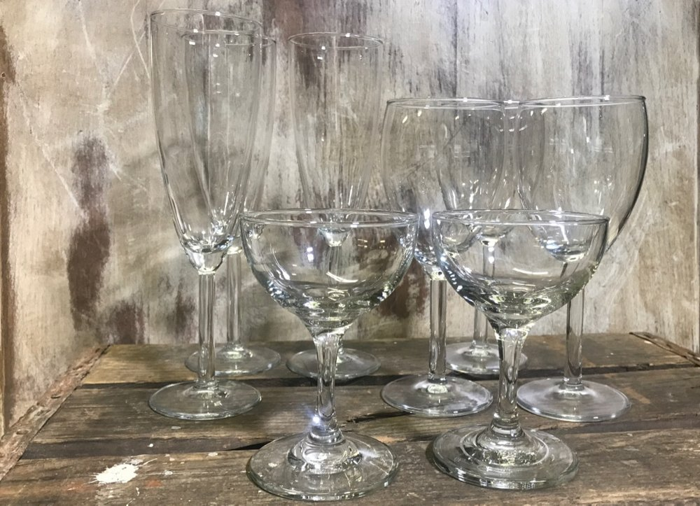 classic matching drinking glasses, goblets, water glasses, stemless goblets, coupes, champaign flutes, red wine glasses, white wine glasses, modern glasses, Wedding rentals in the Temecula Valley,