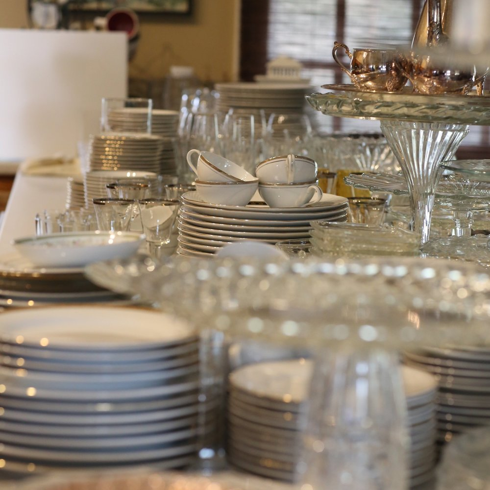 Stacks of vintage dishes ready to be wrapped and put away in the barn in Murrieta, only 10 miles away from the Temecula Valley,