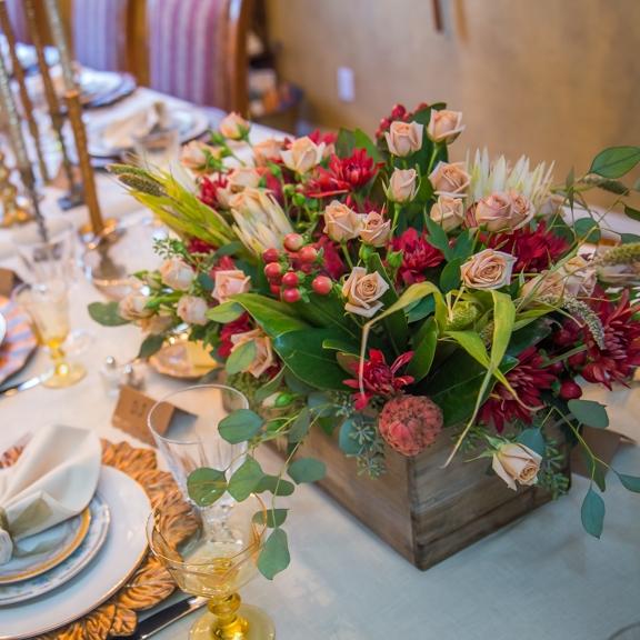 Wooden boxes that hold floral arrangements.
