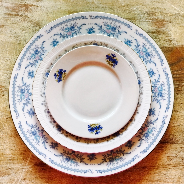 Mismatched vintage china with blue colors.  Dinner plates, salad plates, dessert plates, bread plates. Temecula Vintage Event Rentals.