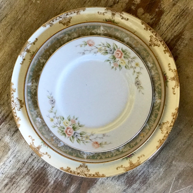 Vintage event rentals in the Temecula Valley. Yellow, brown, green vintage china pieces.  Dinner plates, salad plates, bread plates.
