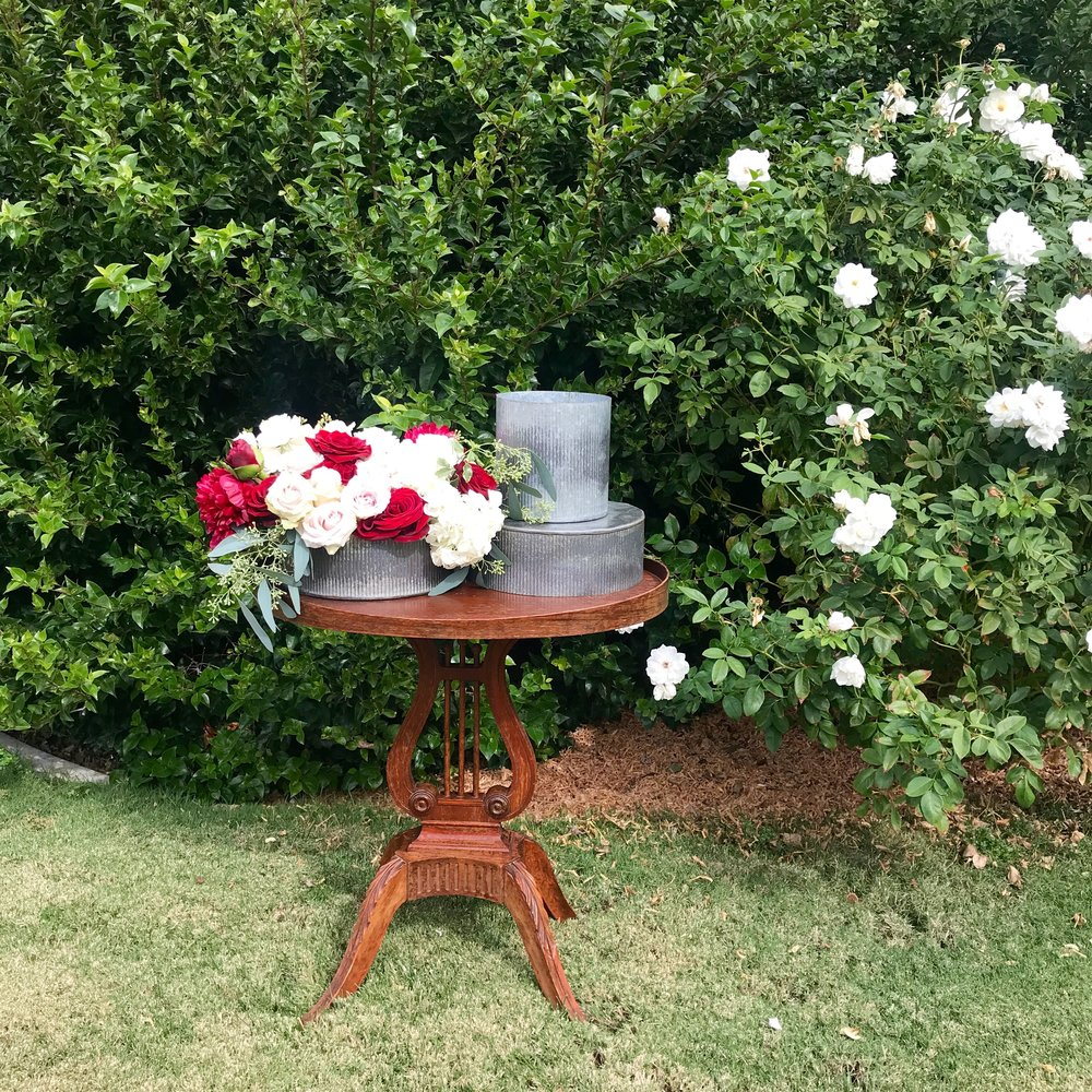 Galvanized flant holders or centerpiece container on harp table.