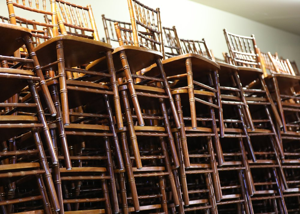 fruitwood chivalry chairs stacked in the barn