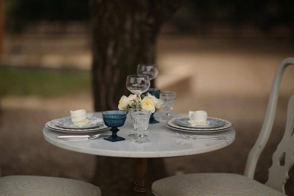 Temecula Valley wedding and event rentals set on a sweetheart table for two  Vintage blue china.