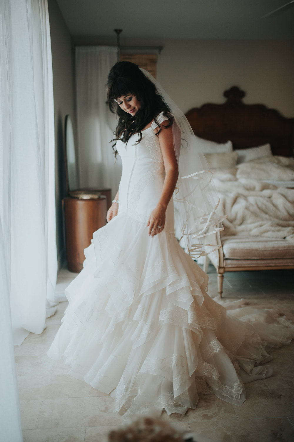 Bride in bridal suite at Chateau Adare wearing Truly by Zac Posen.