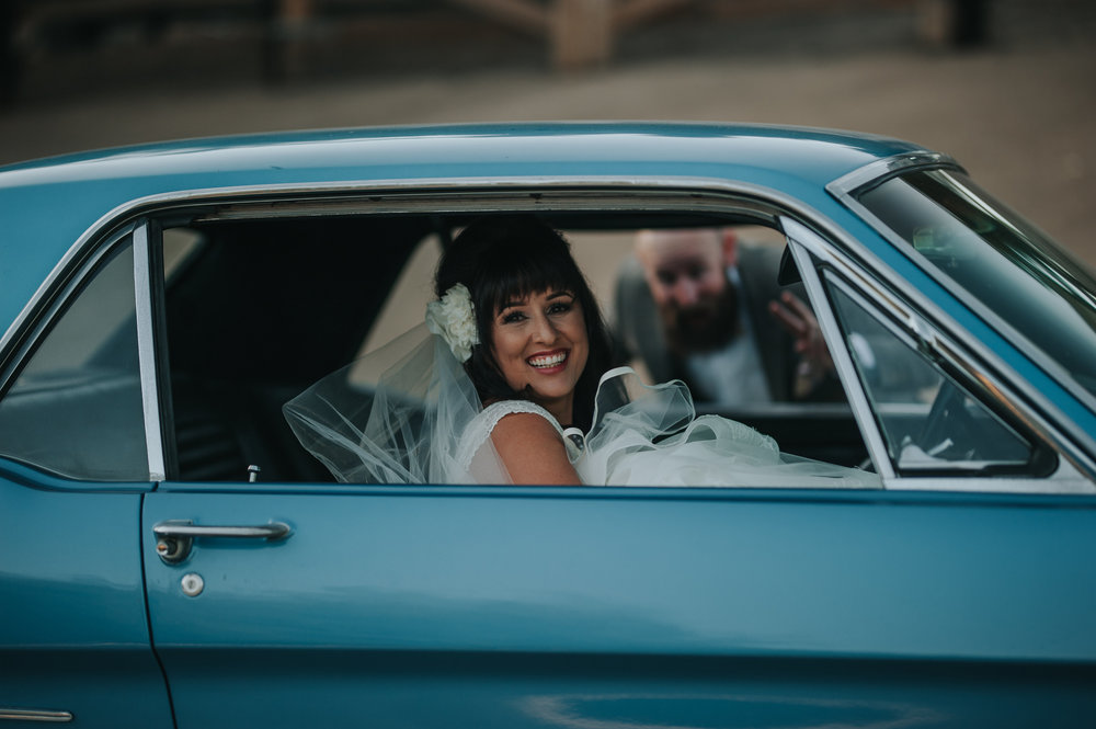 Bride wearing Zac Posen, riding in 1966 vintage Mustang, in the Temecula Valley.