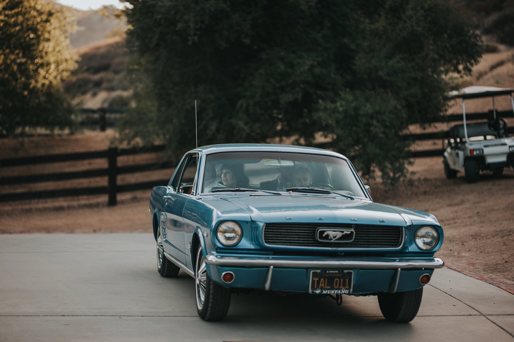 Vintage 1966 blue Ford Mustang in the Temecula Valley at Chateau Adare.